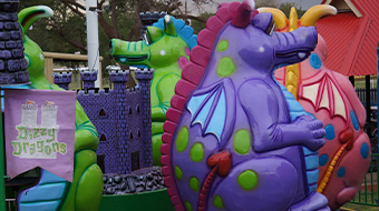 The Dizzy Dragons. Riders between 36 inches and 42 inches must ride with an adult.