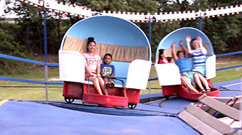 The Tilt-A-Whirl. Riders between 36 inches and 42 inches must ride with an adult.